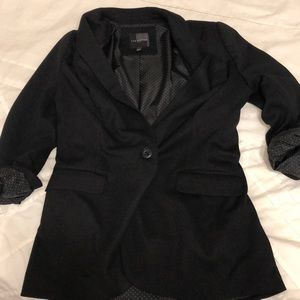 Black one-button blazer with polka dot lining